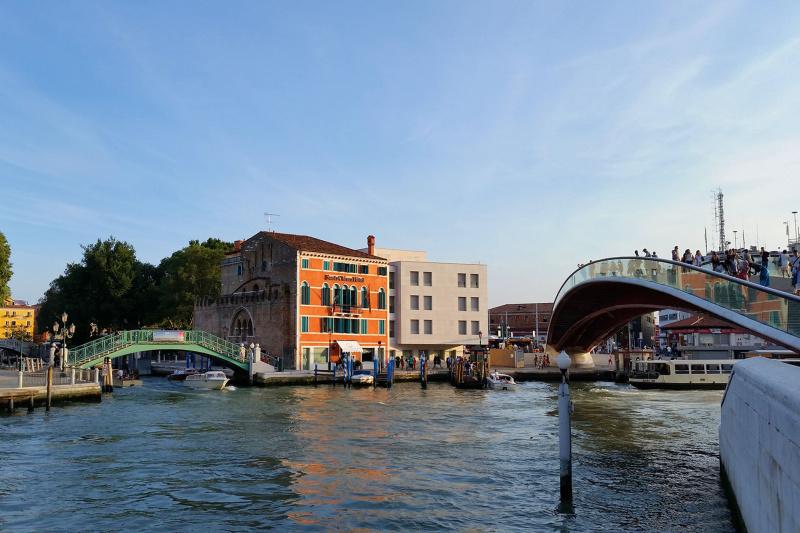 Hotel Santa Chiara exterior with bridges crossing the adjacent waterway