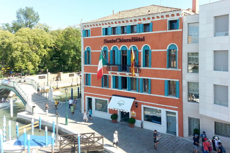 Hotel Santa Chiara historic exterior with step free entrance and canalside views