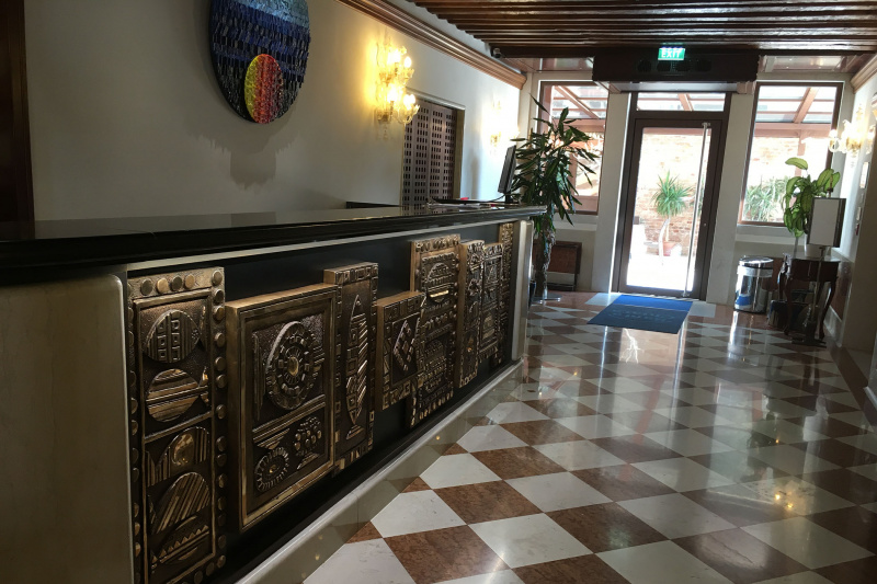 Standing height front desk with ornate detailing