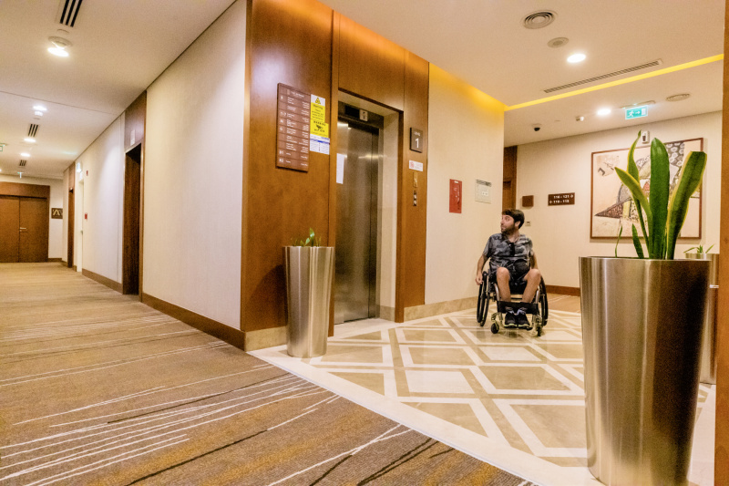 Guest waits at elevator with step-free entrance