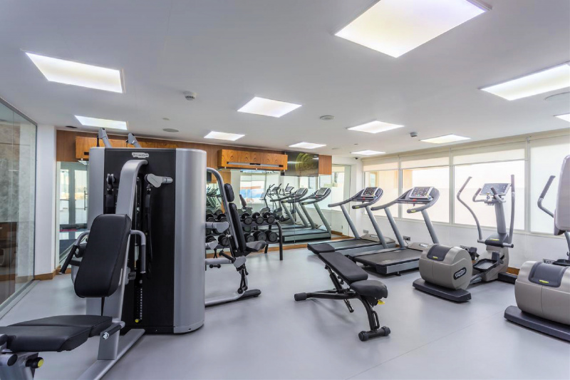 Hotel gym with treadmills and addtional exercise equipment
