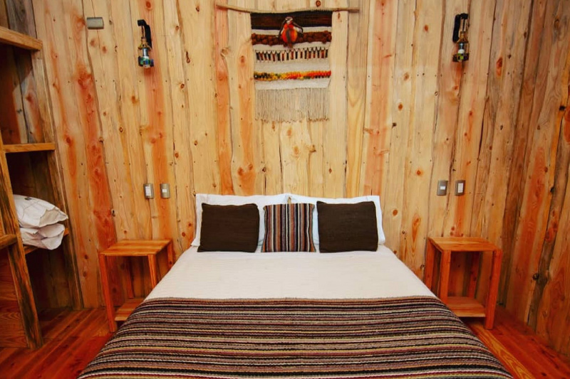 A queen size bed in the cabin.