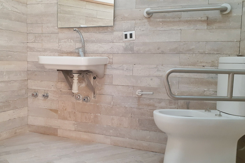 Common bathroom with accessible sink and toilet