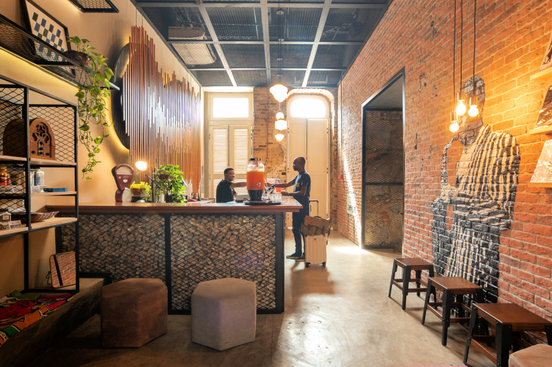 Hotel front desk with lobby with trendy artwork and industrial style decor