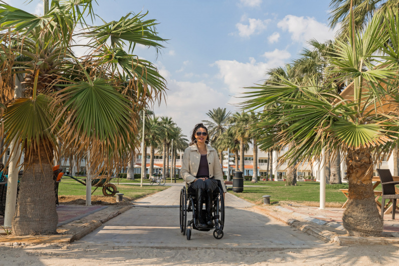 Guest wheelchair user at accessible pathway