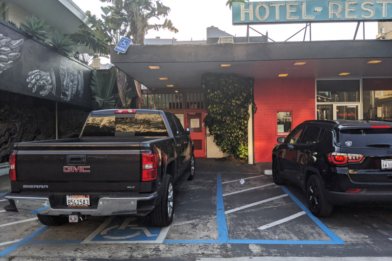 Hotel entrance with ADA accessible parking