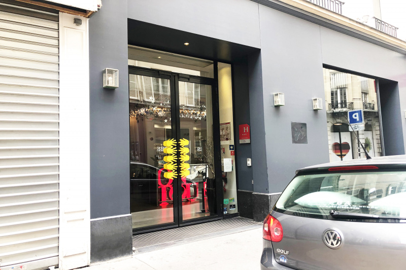 Wide, floor level front doors with unique hand design