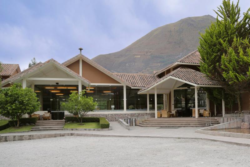 Ramped entrances of Casa Andina Premium Valle Sagrado with patio seating and mountain views