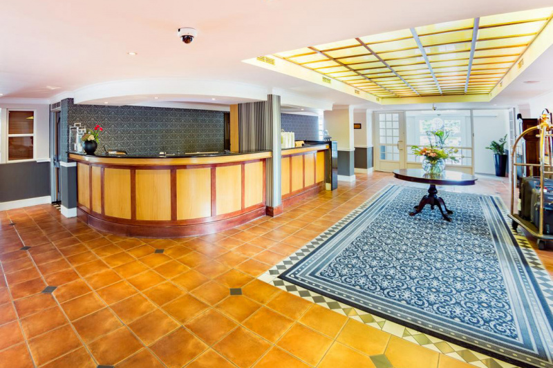 Lobby with standing height front desk and free turn space