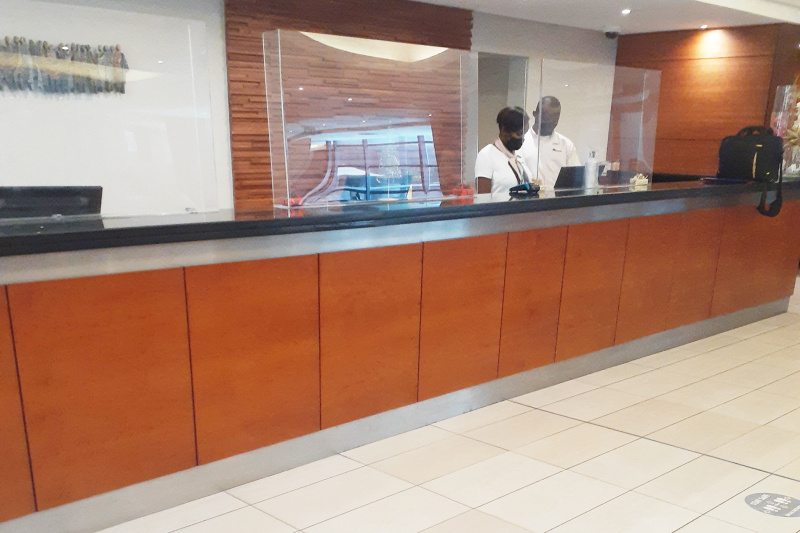 Hotel attendants at standing height front desk