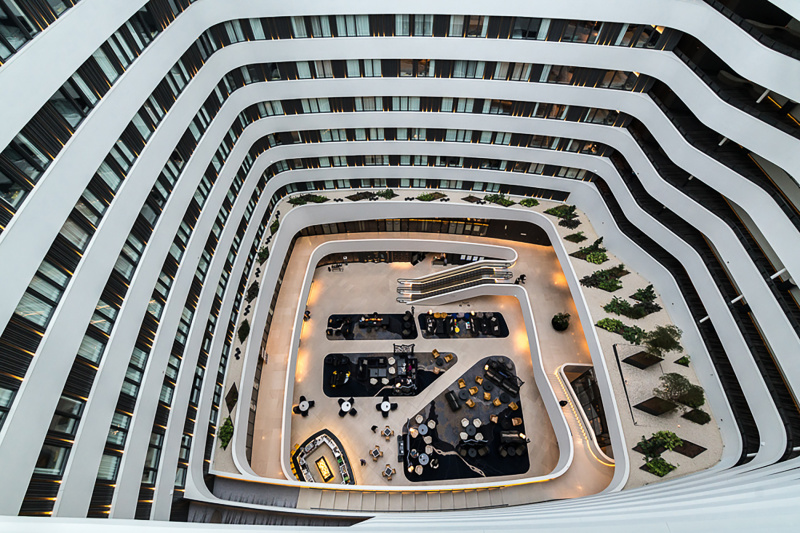 Rooms have a bird's eye view of the elegant lobby and bar