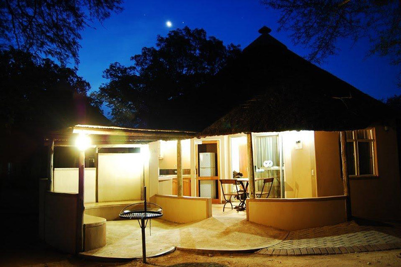 Bungalow and outdoor seating with smooth cement floors