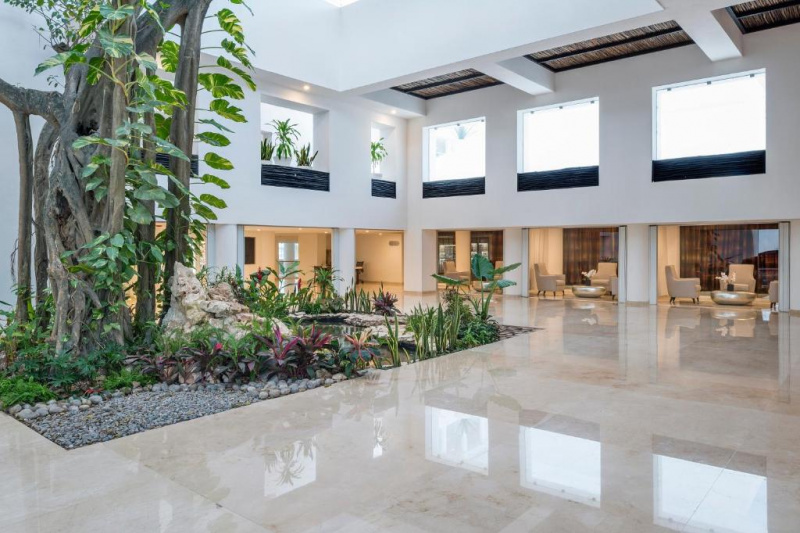View of the spacious lobby with many windows and plants