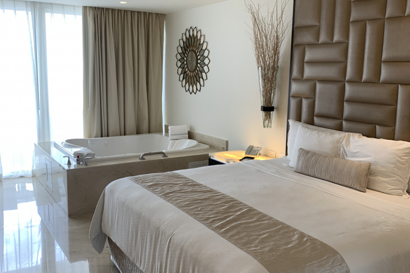 Double bed and a spa bath inside the room