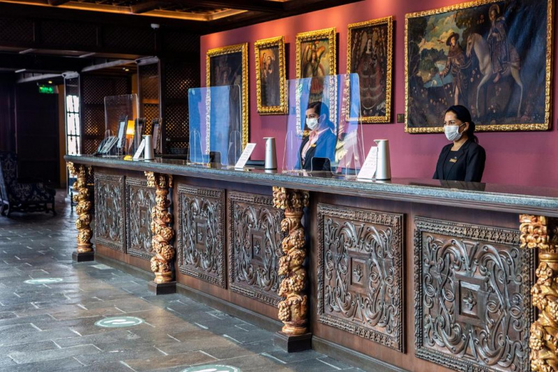 Standing counters at the reception with 3 different reception desks.