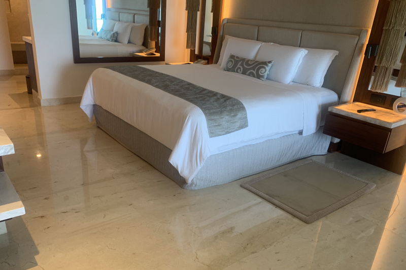 A guest room with a large double bed.