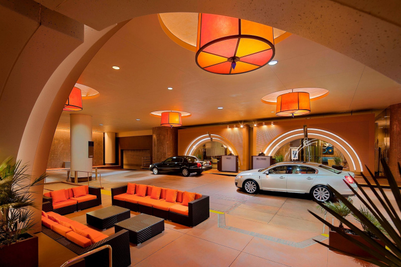 Entrance with seating area and valet for your car.