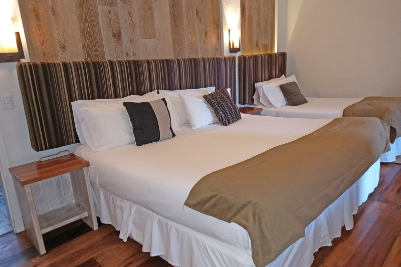 Triple room with a double bed, a single bed and extra room next to the beds.
