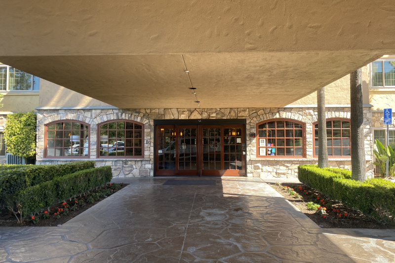 Entrance with stone hallway and sliding doors.