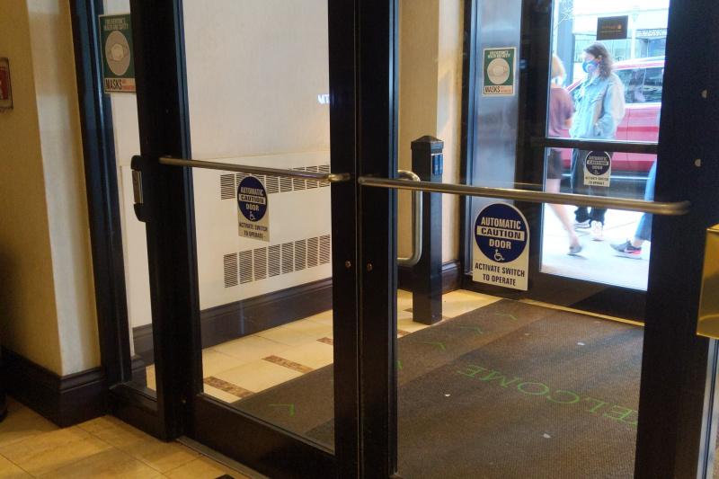 Entrance doors with handicap push button.
