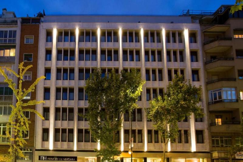 Hotel facade by night.