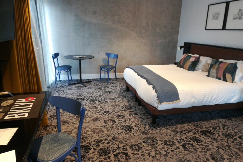 Liberty accessible suite with wide space around the bed and carpeted floor