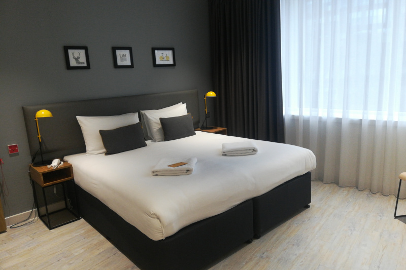 Accessible room with a king-size bed or 2 twin beds. Wide space around the bed for a wheelchair.