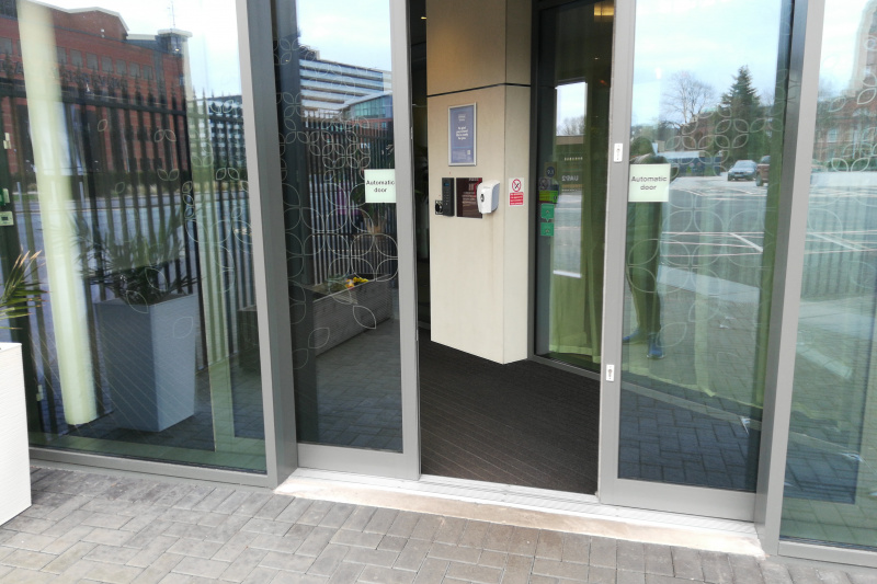 Large, automatic glass doors at the hotel entrance.