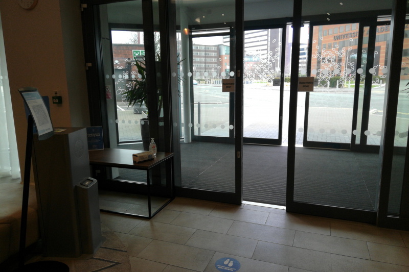 Large automatic glass doors at the hotel entrance.