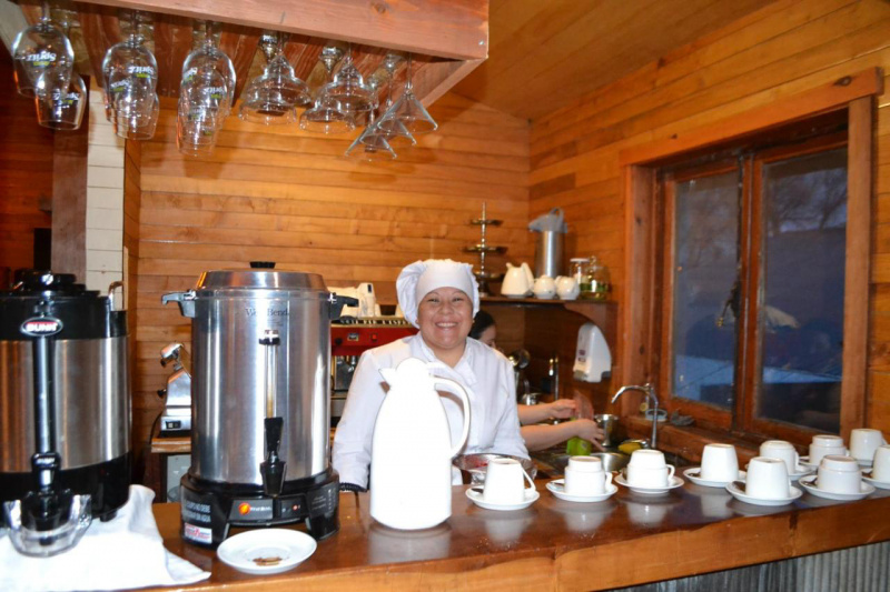Breakfast area with staff member ready to serve your coffee.