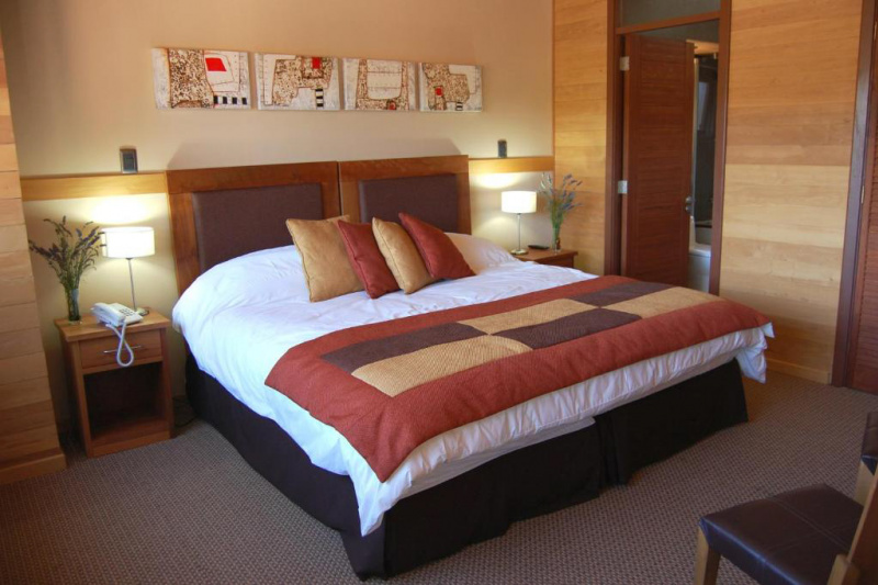 Room with wide space around the bed.