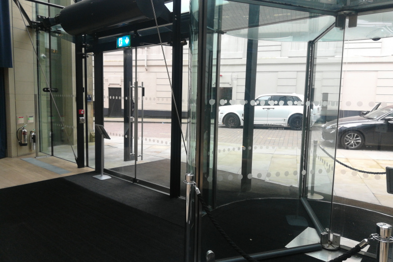 Stepfree entrance with revolving doors