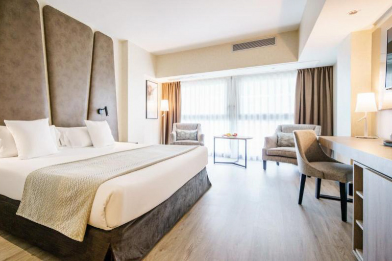 Illunion Malaga accessible room featuring a king sized bed.