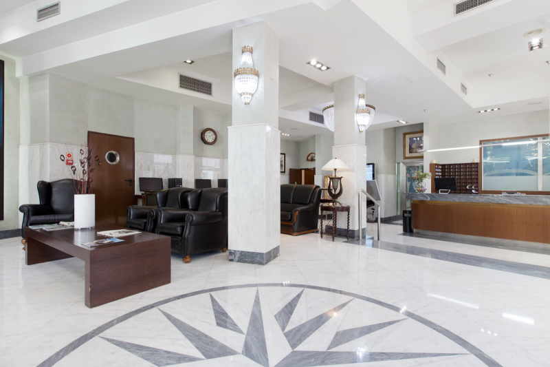 Smooth floored lobby with a standing front desk