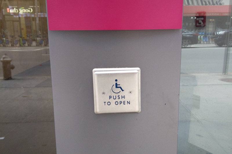 A button at the entrance to provide assistance for people with disabilities