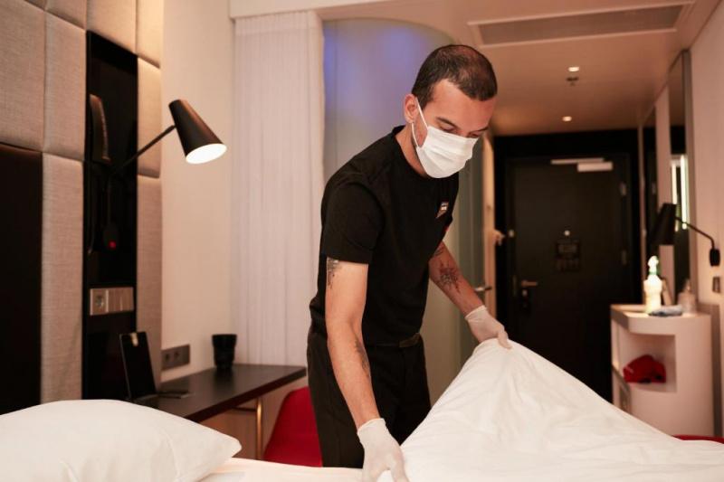 Housekeeping cleaning guestroom