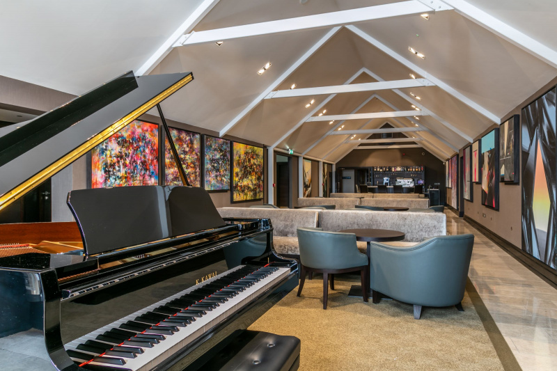 Hotel lounge space featuring a grand piano