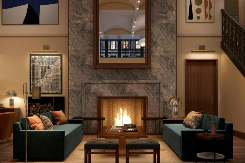 Modern hotel lobby with a lit fireplace