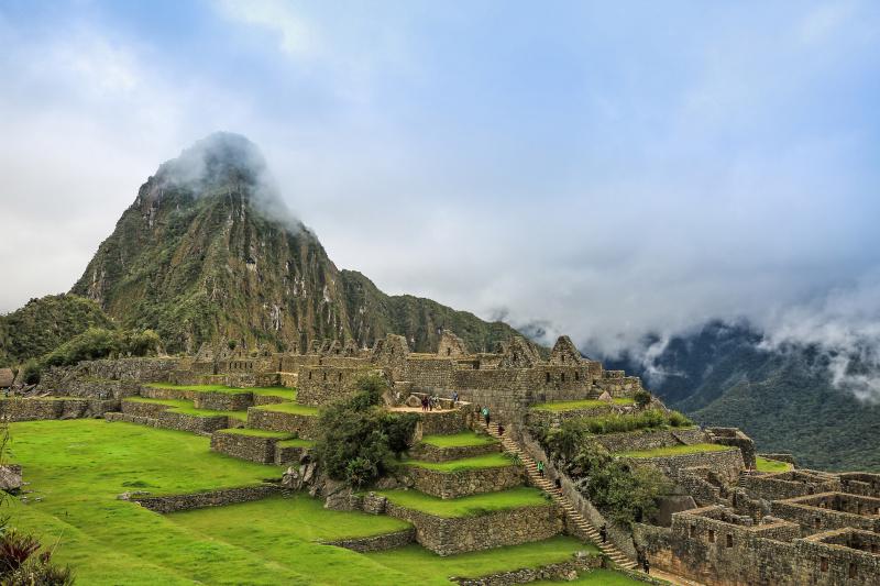 Poeple exploring Machu Picchu ruins