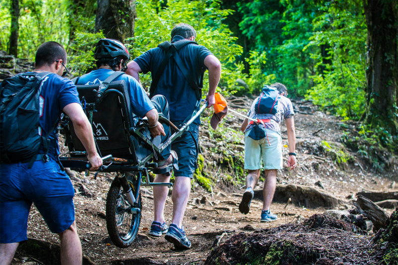 Wheel the World traveler using adapted wheelchair to hike the trails.