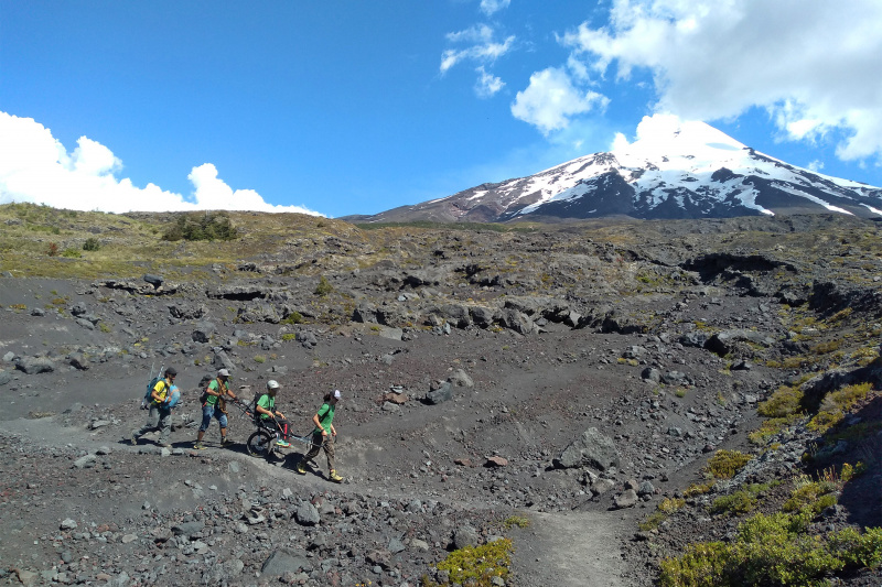 Wheel the World travelers explore the base of Villarrica Volcano.