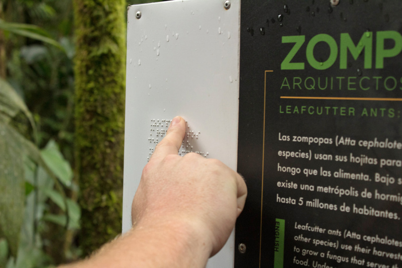 Signs with brail language and park information are scattered throught out the park.