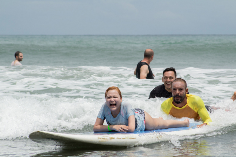 Wheel the World Traveler surfing with instructors
