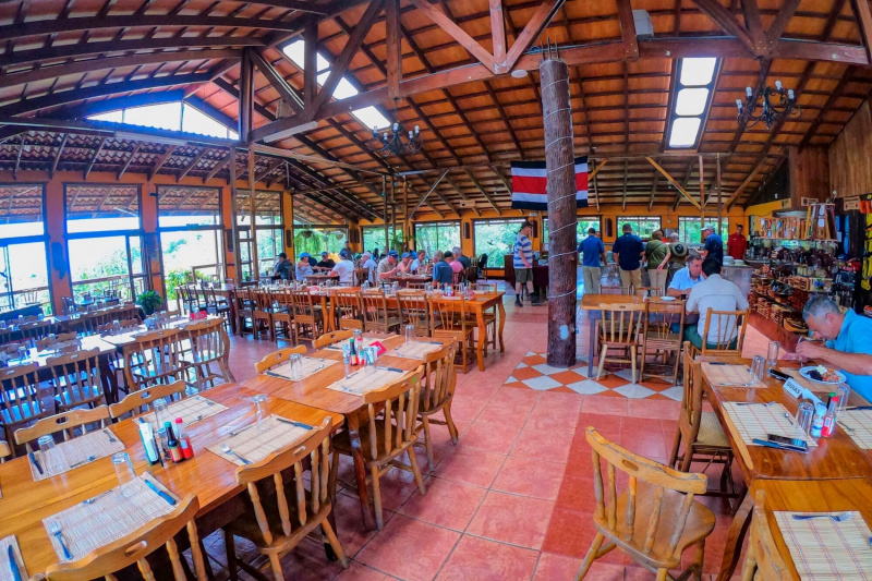 Guest enjoying resturant with step free access and tables at an accessible height