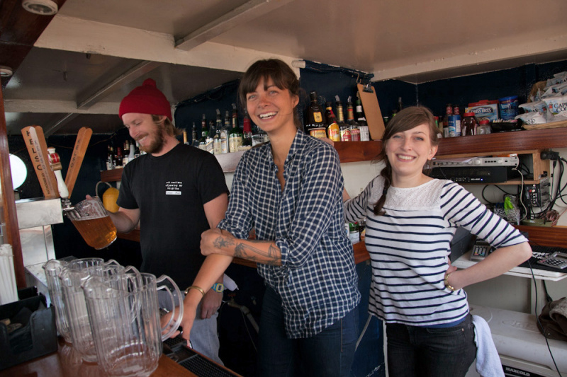 Bartenders prepare drinks for visitors on the Boat Tour