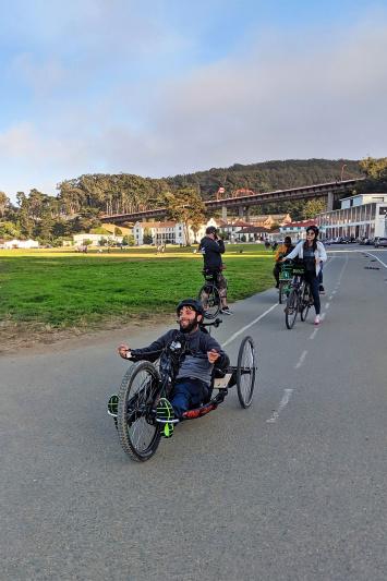 Travelers bike near Crissy Feilds near the Golden Gate Bridge