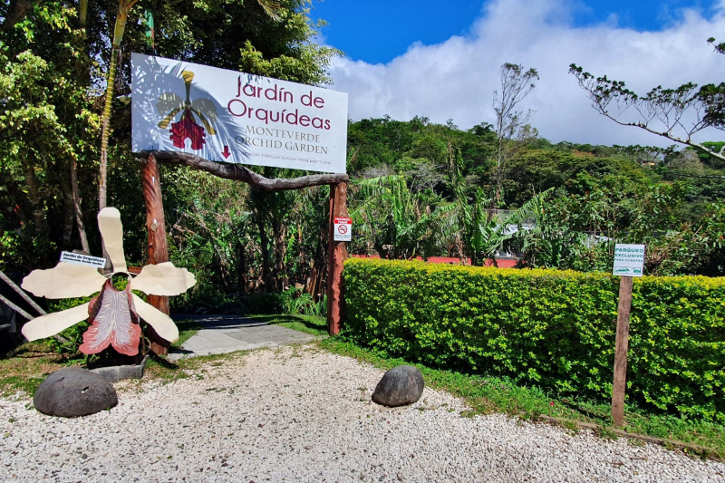 Monteverde Orchid Gardens entrance with paved pathway
