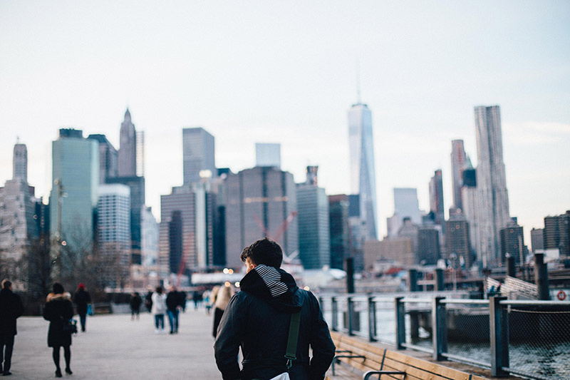 Traveler walks strolls down pier 11