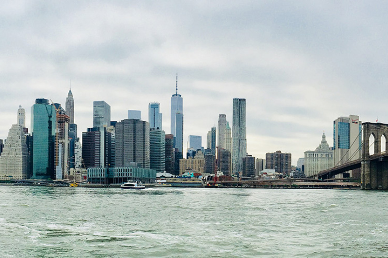 Ferries move about the east river