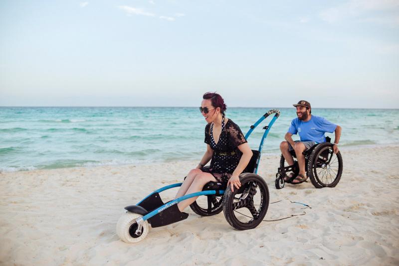 Travelers in wheelchair enjoy Isla Muere's beach
